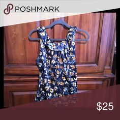 Sleeveless floral print blouse. Prepare for spring with this sleeveless Ann Taylor blouse.  Perfect for jeans and sandals or tucked into a pencil skirt and jacket for a statement piece. Ann Taylor Tops Tank Tops