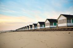 I agree with the photographer #elizabethst on etsy:  A beautiful 8x12 fine art print, taken at sunset. A long row of cottages, all resting till summer's arrival. This photograph was taken in North Truro, right at the 'bend in the wrist' of Cape Cod, looking North toward Provincetown.    One of my favorite places in the world, full of memories. The light on Cape Cod is unique; like nowhere else in the world. It's beautiful.