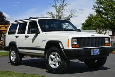This 1997 Jeep Cherokee Sport is the final revision to the XJ Jeep Cherokee's styling, and includes the updated bodywork and dash used through the end of production. Powered by a 4.0L inline-six, this 91K mile example remains nearly stock, wears new tires, and has nice cosmetics throughout.