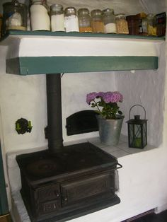 This cast iron stove looks like a retro-fit onto an ancient cooking hearth
