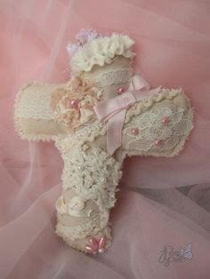 This cross shaped brooch can make any outfit look more cult party kei. It is adorned with scraps of fabric, beads and vintage lace. It is about 4.5 inches tall and 4 inches wide.