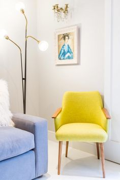 A striking yellow midcentury tub chair with an Italian midcentury light and Scandinavian artwork.  Browse and buy midcentury furniture and preloved #design at Layer.