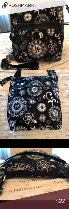 "Beautiful Thirty One Purse This Thirty One Purse is in excellent preowned condition.  It has an adjustable shoulder strap and a zippered top.  There is a zippered pocket in the front and another pocket on the back. Inside there are 2 regular pockets and one zippered pocket.   This purse has lots of room!  Measurements are: 12"" x 11"" x 1"". Thirty One Bags Crossbody Bags"