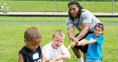 James Madison University football student-athletes pitch in at Stone Spring Field Day on June 4th, 2014.