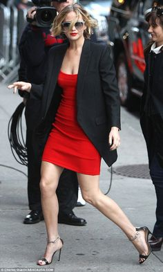 Jennifer Lawrence.. red Antonio Berardi Pointelle-Trimmed Jersey Dress, and Manolo Blahnik Chaos Sandals..