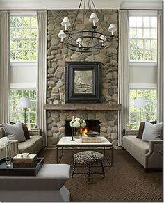 Floor to ceiling river rock fireplace, Why not try this on plywood mounted to the wall behind an electric fireplace, maybe even mount some of the river rock directly on to the electric fireplace for a custom look.