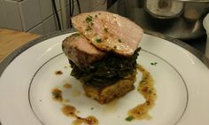 pork loin with savory bread pudding and mustard greens from Restaurant Gwendolyn in San Antonio