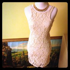 White lace peek a boo dress. Very classy white lace peek a boo dress. Perfect for a date or girls night out. No Trade Dresses