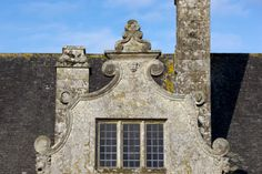 Detail of the Dutch-style gable on the east front at Trerice, Cornwall. This facade of the manor house is dated c.1570.