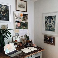 Art and writing nook. Large botanical chart, blue variations, mixed media print by Susan Farrington (above the desk). Blue & White Ikat Paisley Framed Wall Art (next to the desk) Christine Lindstrom/Mai Autumn available framed on wanelo.com.