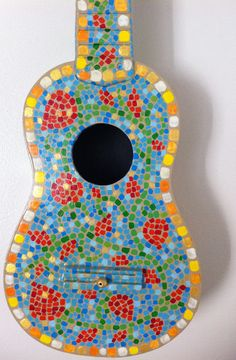 Painted Flower Ukulele. $155.00, via Etsy. This is quite lovely.