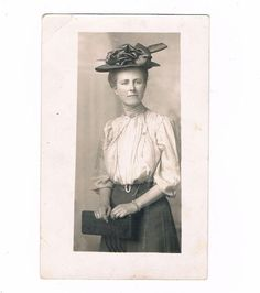 "Real photo postcard of a 1910's woman wearing a big hat. She is identified on the back as Jessie Rearder ""my first school teacher"". Sharp image. Etsy $8.99"