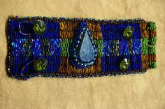 Couture bracelet Lapis stone peyote technique on leather interior