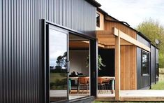 Really like how these materials bring character to what could've been a plain look. stained cedar cladding vertical with metal cladding - black Steel Cladding, Cedar Cladding, House Cladding, Exterior Cladding, Black Cladding, Wall Exterior, Wall Cladding, Metal Building Homes, Metal Homes