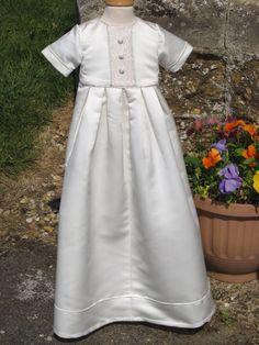 Wedding -> baptismal gown.  Could add my mom's lace down the middles of this one and would still be unisex enough probably.