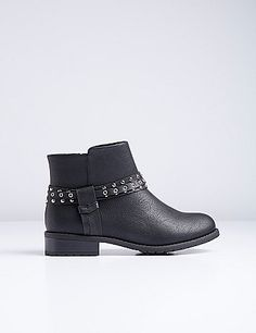 An ankle strap with studs and grommets gives this already-edgy moto boot some extra attitude. Modest heel adds some height. Side-zip closure. Wide widths. lanebryant.com