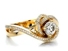 This elegant engagement ring features a round brilliant cut diamond in a four prong yellow gold setting, with bright cut set diamond accents on the wrapped split shank. Designed and created by Joseph Jewelry Elegant Engagement Rings, Diamond Engagement Rings, Saphir Rose, Morganite Engagement, Pear Shaped Diamond, Ring Verlobung, Schmuck Design, Silver Diamonds, Diamond Wedding Bands