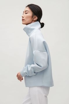 COS image 12 of Oversized high-neck sweatshirt in Pale Blue