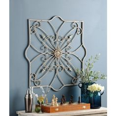 """Emma Metal Wall Plaque. $49.00.  32 """" X 32 """". I wish it were a darker color.  Of course, it can always be painted oil rubbed bronze or black."""