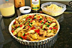 California Quiche. A veggie lover's egg dish with fresh zucchini, red bell peppers, onion, and artichoke hearts.