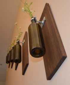Wall vases- try using miniature spirit bottles instead (going up my stairs I think)
