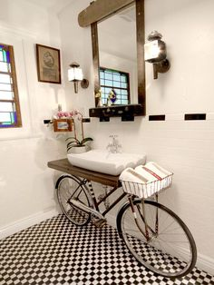 Okay, how cute is this upcycled bike, used as a bathroom vanity? I love it with the black-and-white tile! #architecturedesign #homearchitecture