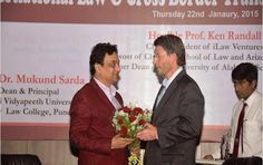 Prof. Dr Mukund Sarda, Dean Faculty of Law and Principal of New Law College ‪#‎Pune‬, Felicitating 'Hon'ble Prof. Ken Randall, CEO/President of iLaw Ventures , Provost of Charlotte School of Law and Arizona Summit, former Dean of the University of Alabama School of Law, on 22nd January 2015