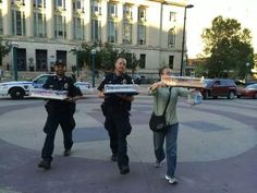 This picture of two cops bringing cake to newlyweds after Wisconsin's ban on same-sex marriage was found unconstitutional: | 32 Pictures That Will Change The Way You See The World