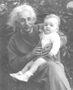 Robbie Steiding sits on the lap of Albert Einstein during a 1946 secret visit that Einstein made to Western Maryland. The famous scientist was invited by Robbie's father, John Steiding of Midland, to vacation at Deep Creek Lake.