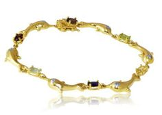 14k Yellow Gold Over Sterling Silver Dolphin Multi Gem and Diamond Bracelet JewelExcess. $21.99. Arrives in a FREE Gift Box, ready for that special someone.. So elegant and gorgeous, make them the most perfect diamond jewelry for day and night for any occasions and events.. This bracelet features heart shaped links accented by genuine Garnet, Topaz, Amethyst, Citrine, Peridot, Diamond stones. The bracelet is crafted of 18k gold over sterling silver and is secured with a box cl...