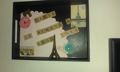 Took a tray from Targets dollar area and added stickers, paper, etc.  Hot-glued on Scrabble Tiles with one of my fav quotes.  Hung on the wall and set a Mini Metal Tower on the ledge.