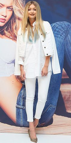Gigi Hadid (with blue hair!) in all-white jeans, shirt, and denim jacket