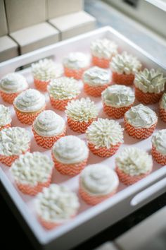 #cupcake, #orange, #baby-shower  Photography: Greer G. Photography - greergphotography.com  View entire slideshow: Prettiest Wedding Cupcakes Ever on http://www.stylemepretty.com/collection/1206/