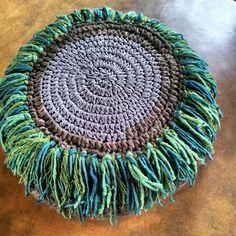 Green fringed floor cushion