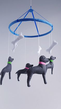 Mobile with dogs weimaraners.Dogs sewn from grey felt.Eyes embroidered with blue thread.Bone color ivory sewn from felt.You can email me if you want another color collars.You can order a different color felt for the circle and tape,just email me.I accept custom orders on a mobile.  Hoop 9.4 inches (24 cm) Dog 5 x 5 inches (13 x 13 cm) bone 3 inches (8 cm)