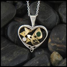 Sterling Silver and Gold Trinity Knot or Triquetra knot pendant set with a diamond and Tsavorite.