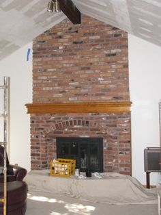 Another recessed square firebox with outer brick arch - Floor to ceiling brick fireplace makeover ...