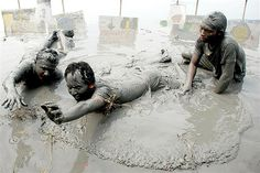 May 30, 2013: Protesters lie in the mud along a retaining dike to mark the anniversary of the event that created the deadly Lusi mud volcano in Sidoarjo, Indonesia. The mud flow, created by the blowout of a natural gas well in 2006, has killed more than a dozen people & forced thousands to flee their homes. The company that drilled the well, PT Lapindo Brantas, has argued that Lusi was created by a natural disaster.