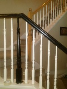 Painting stair rails black. Love my home depot lady who recommends using rustoleum paint making my projects easier.