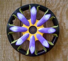 1002121031a 600x539 Recycled Hubcaps in metals art with Recycled Green Garden Flower decor Art