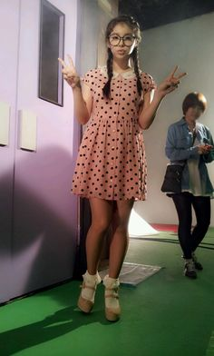 "I love this outfit that Ailee wore in her ""I Will Show You"" music video with the pink and black polka dot dress with the white embroidered collar along with the white lace socks and pastel pink pumps."