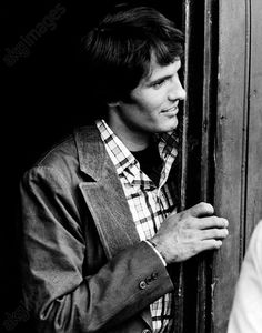 akg-images -talian actor Giuliano Gemma posing leaning against a door. Rome, 1973