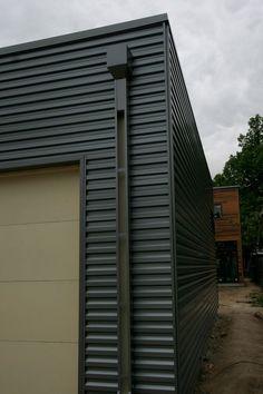 Corrugated steel siding