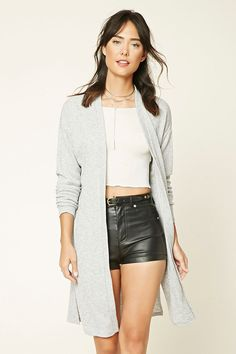A ribbed marled knit cardigan featuring an open front, longline silhouette, slit sides, and dropped long sleeves.
