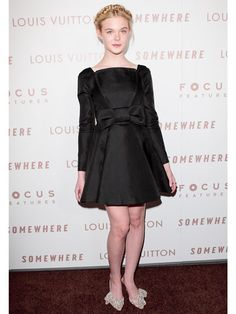 All tied up in Valentino with bows from head to toe, Elle attended the Hollywood premiere of Somewhere late 2010.