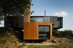 #ShippingContainers The house is the first modern shipping container construction designed and built in Northern Ireland, with the primary structure made up of four 45ft shipping containers, merged together to form two large daring cantilever forms. Have an idea of your perfect dream home? Let's build it using shipping containers! Email us at sales@modernblox.com ©archdaily