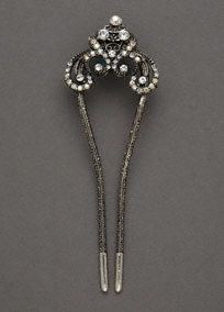 """You'll look polished and stylish in this elegant hair pin!  Rhodium plated hair pin features sparkling crystal accents.  Measures 5 1/2"""" tall.  Imported."""