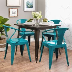 Bring the modern look into your home with this set of Peacock Tabouret stacking chairs. This four-piece chair set is perfect for adding extra seating to any living area or providing a stylish pop of c Table And Chairs, Dining Chairs, Blue Chairs, Rattan Chairs, Accent Chairs, Eames Chairs, Chair Cushions, Pub Table Sets, Bar Tables