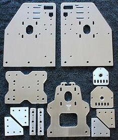 A set of four Gantry Plates for the OX CNC machine, spacer blocks, a set of Universal Threaded Rod Plates so you can use either a Nema 23 or Nema 17 on the Z axis. (The X plate and Spacer blocks can also be used with only 3 wheels) and joiners. Cnc Table, Cnc Plasma Table, Lamp Table, Router Table, Diy Wooden Projects, Cnc Projects, Workshop Storage, Workshop Organization, Toilet Paper Art
