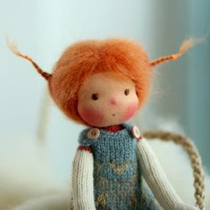 """Scarlet is 14"""" knitted doll. She is looking for a lovely home."""